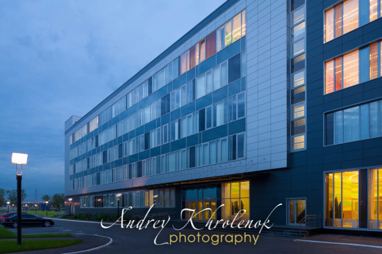 Night lighting of modern office building. Photographer: Andrey Khrolenok